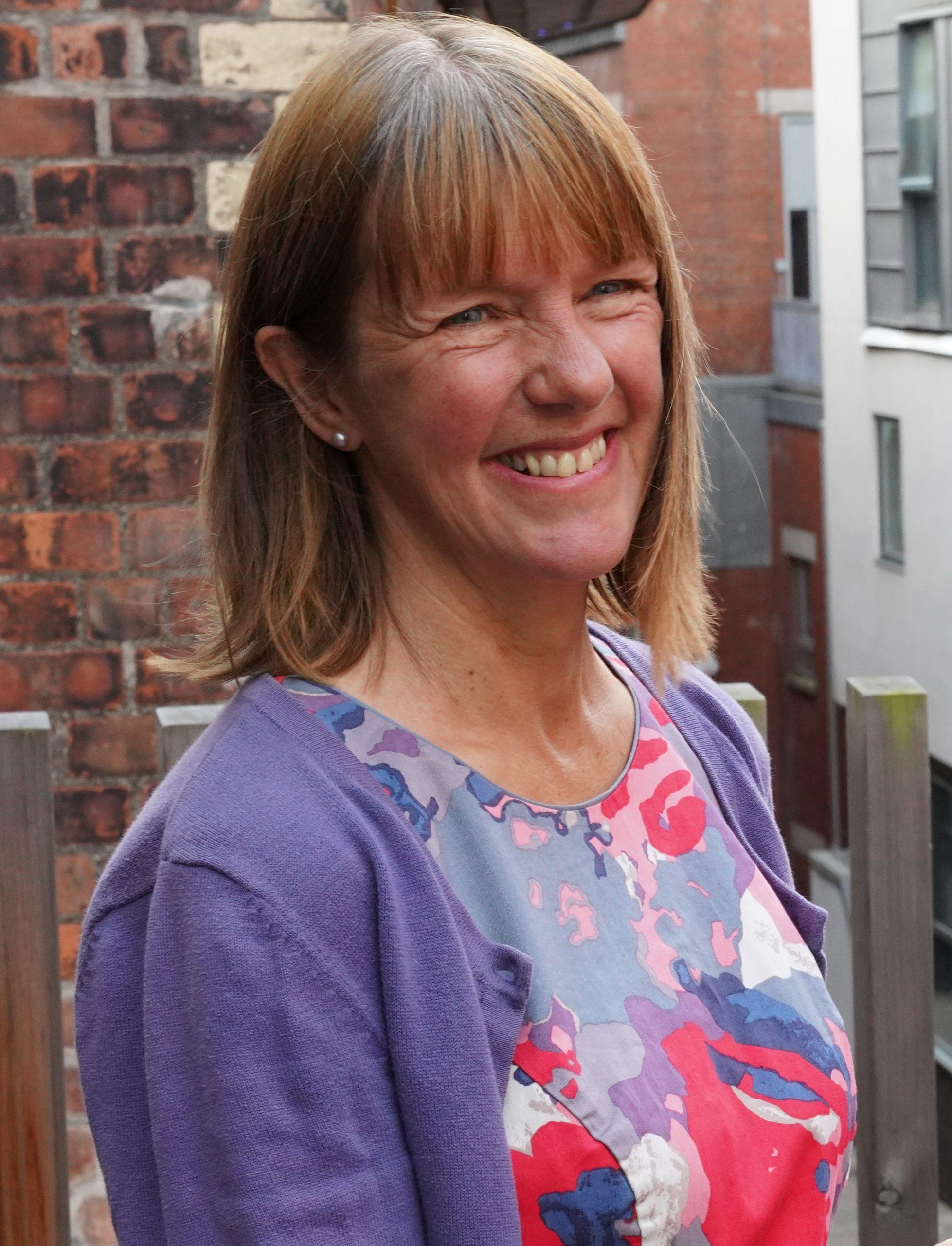 Makar, Kathleen Jamie standing on the balcony at Scottish Poetry Library